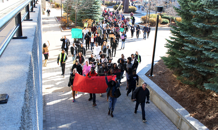 Photo of SUNY Plattsburgh students and faculty marching to support diversity.