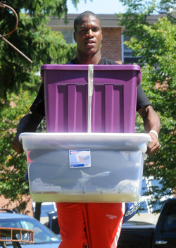 Photo of SUNY Plattsburgh student moving back to campus
