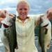 Photo of Nikki Eddy holding 2 prize fish