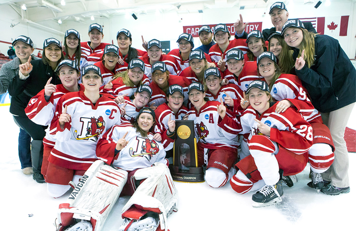 Photo of Women's Hockey team celebrating their victory.