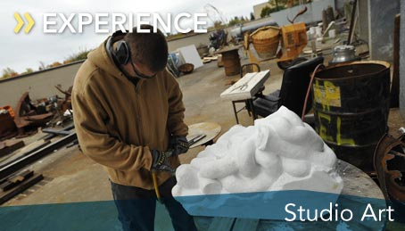 Photo of a student working on a scupture