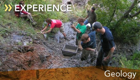 Photo of geology students collecting samples in the field