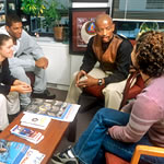Photo of J.W. Wiley, Director of the Center for Diversity, meeting with students in his office.