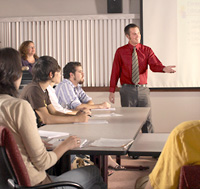 Photo of a student leading a lecture class