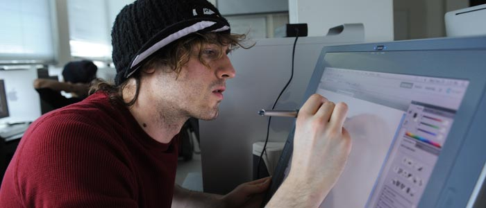 Photo of a graphic design student working on a computer