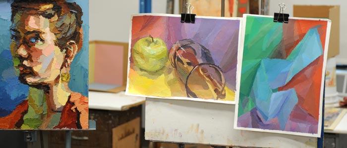 Photo of three paintings