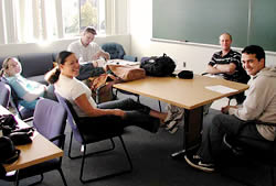 Students relaxing around a conference table