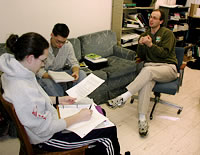 Photo of Will Deutschman talking to students