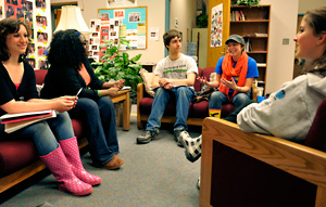 Photo of students having an informal discussion in the honors center lounge