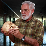 Photo of Mark Cohen holding a skull