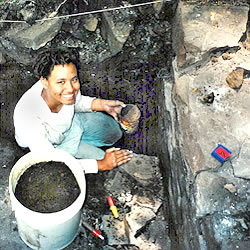 From several feet down in the pit, Cynthia is still happily working on the excavation