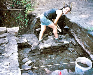 Lenore taking notes in the excavation pit