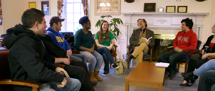 Photo of history students having a disucssion with professor Gary Kroll in the Champlain Valley Hall lounge