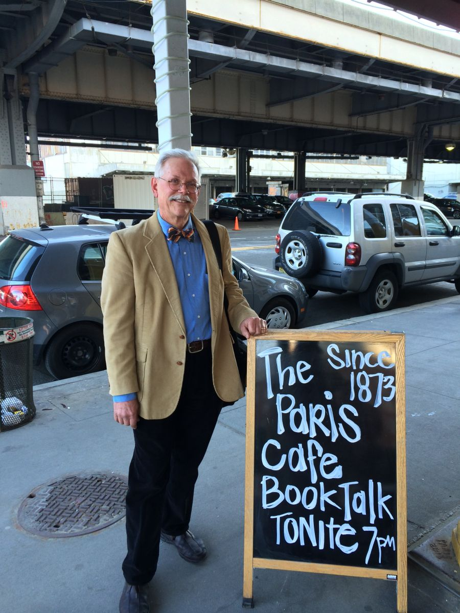 Photo of James Lindgren in front of the Paris Cafe the day he had a book reception there