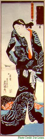 A Japanese scroll painting of a woman in a kimono