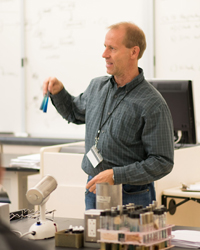 Photo of a professor teaching in a lab