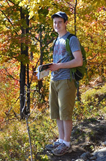Photo of Patrick Montuori hiking in the woods