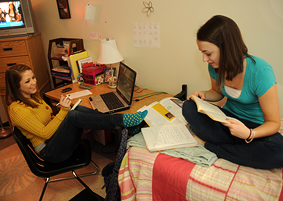 Photo of SUNY Plattsburgh students in dorm room