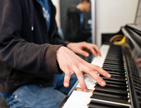 Photo of a student playing the piano.