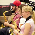 Saxophonists playing at rehearsal