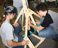 Photo of students building the trebuchet