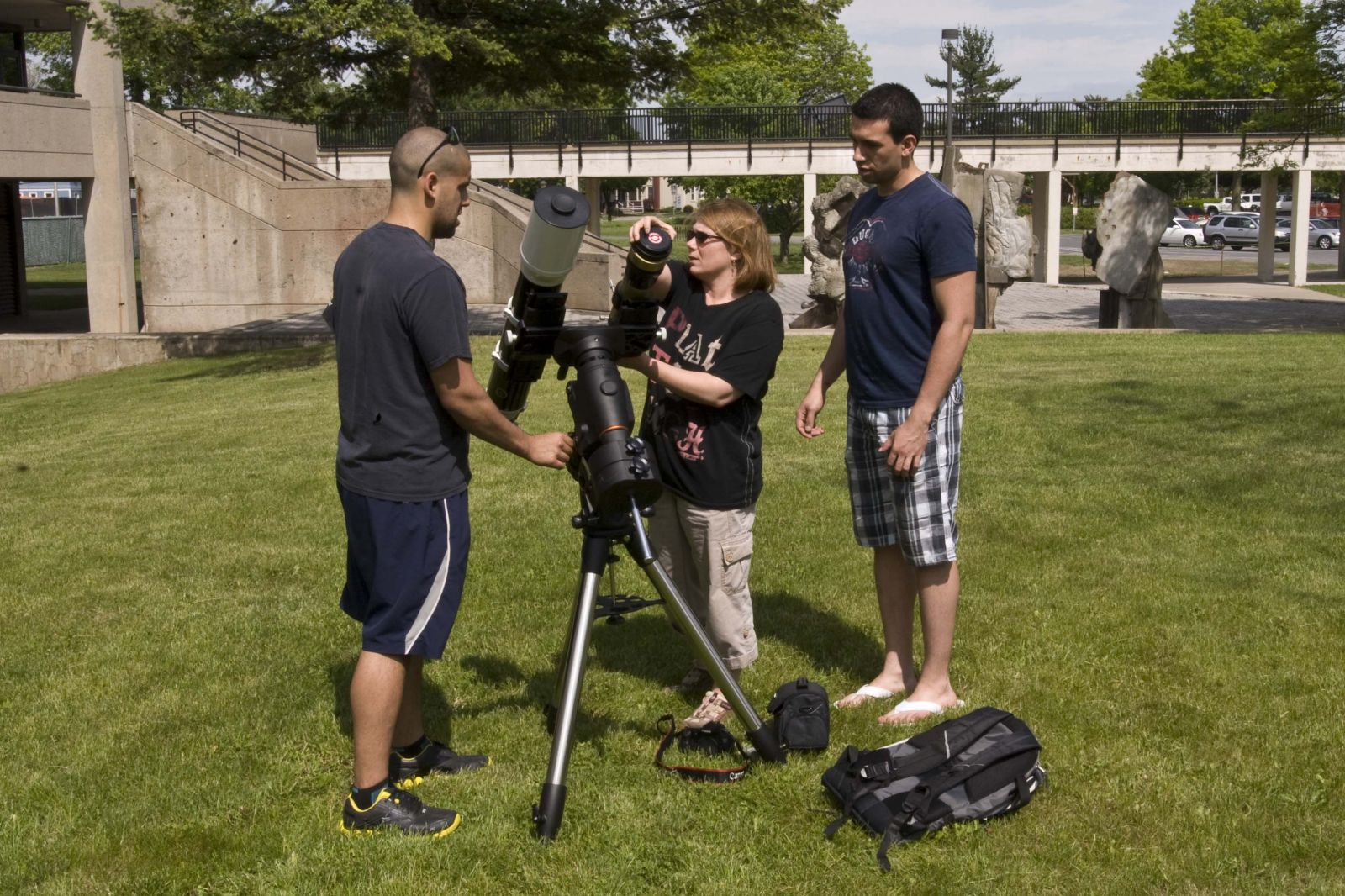 Photo of students working wth a telescope
