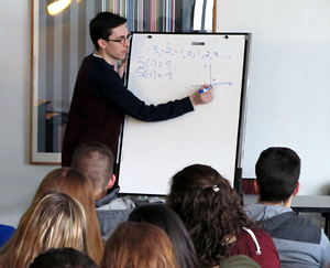 Bradley Johnson, a senior at Plattsburgh State, explains the Gaussian integers during his Math Day talk