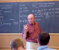 An instructor discusses equations with his class