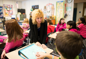 Photo of a student teacher working in a middle school with adelescent age students