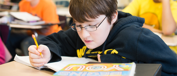 Photo of a student reading in class