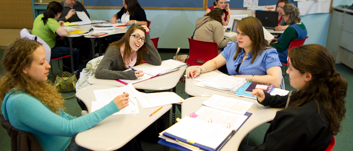 Photo of literacy education students working on group projects in class