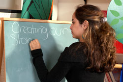 Photo of a teacher writing on the blackboard