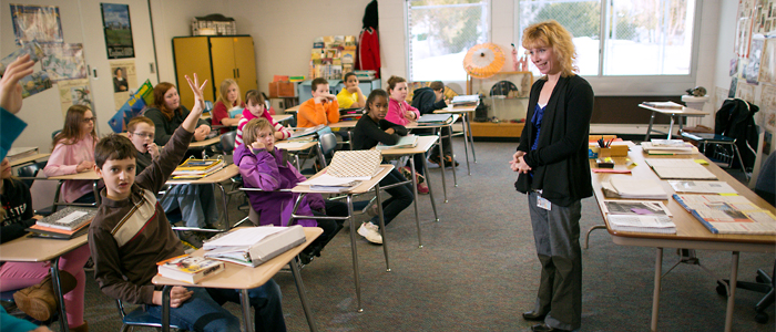 Photo of a student teacher leading a classroom discussion