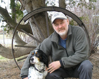 Photo of Charles List outside with his dog