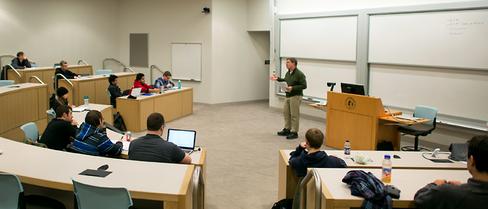Photo of Dr. Jan Plaza giving a lecture to computer science students