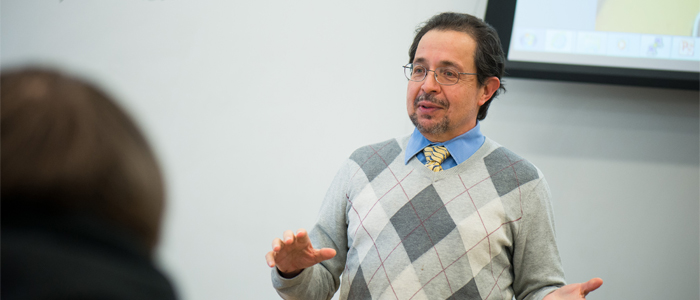 Photo of Dr. Salvador Guttierez lecturing in class