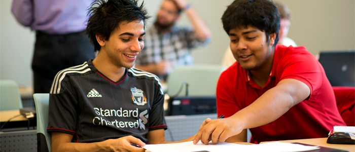 Photo of two students working on a project in class