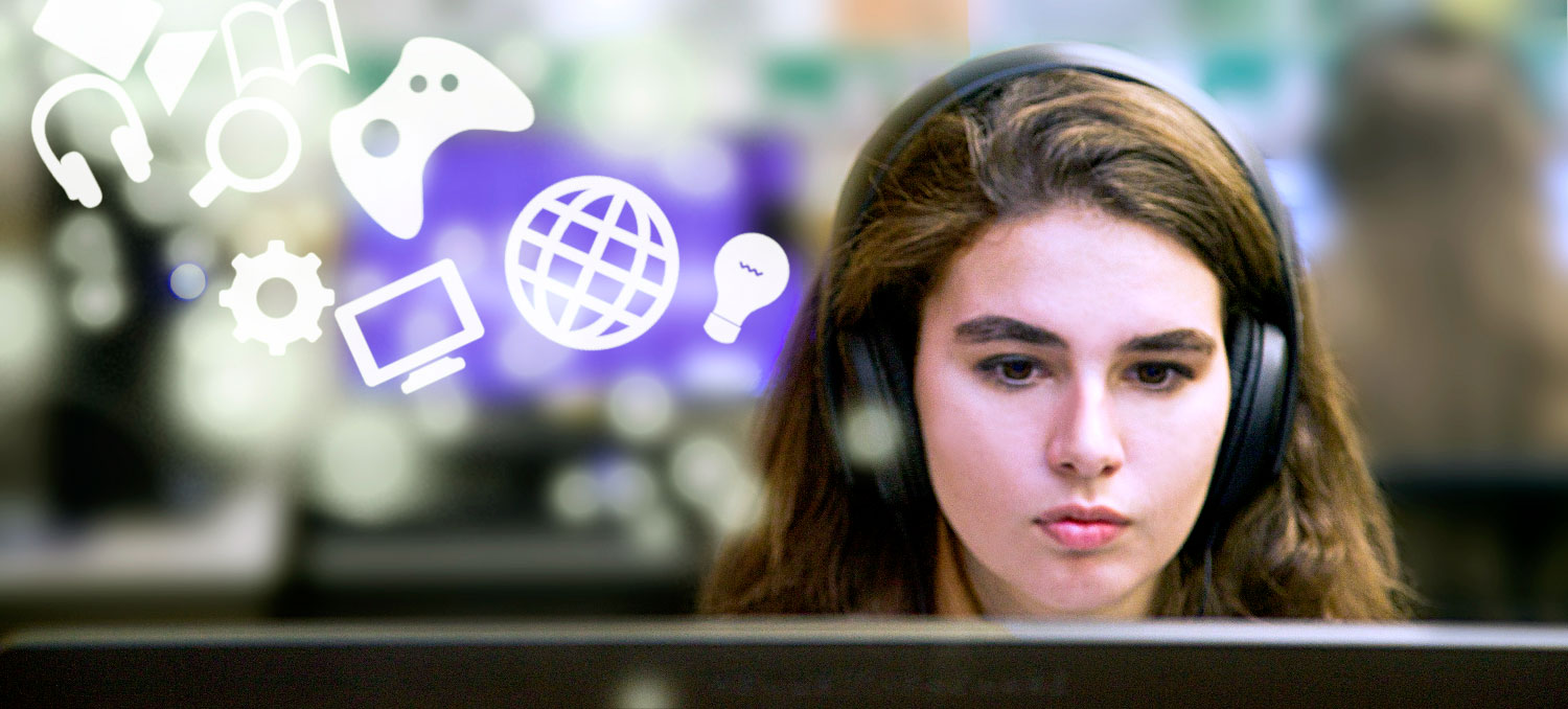 Digital Media Student working on a computer with media icons flowing out of their head.