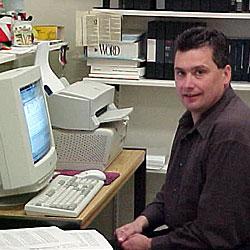 Peter J. Ensel III working in his office