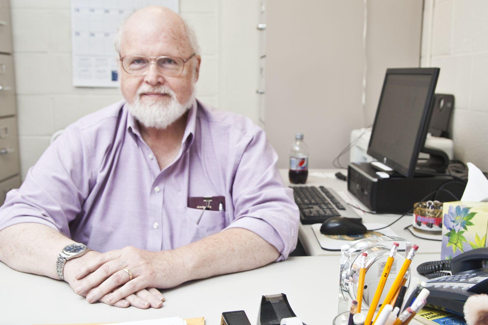 Dr. J. Justin Gustainis