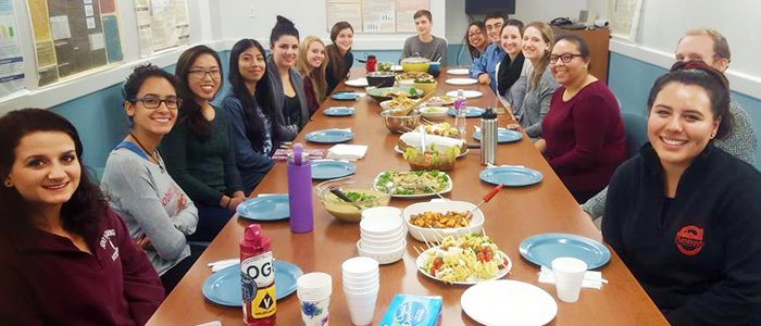 Photo of the Nutritian Association students enjoying a pot luck dinner