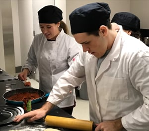 Photo of students cooking in the lab kitchen