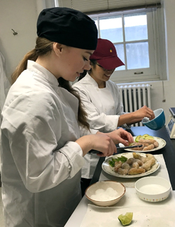 Photo of nutrition students preparing food in the food lab