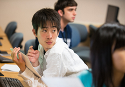 Photo of a student listening in class