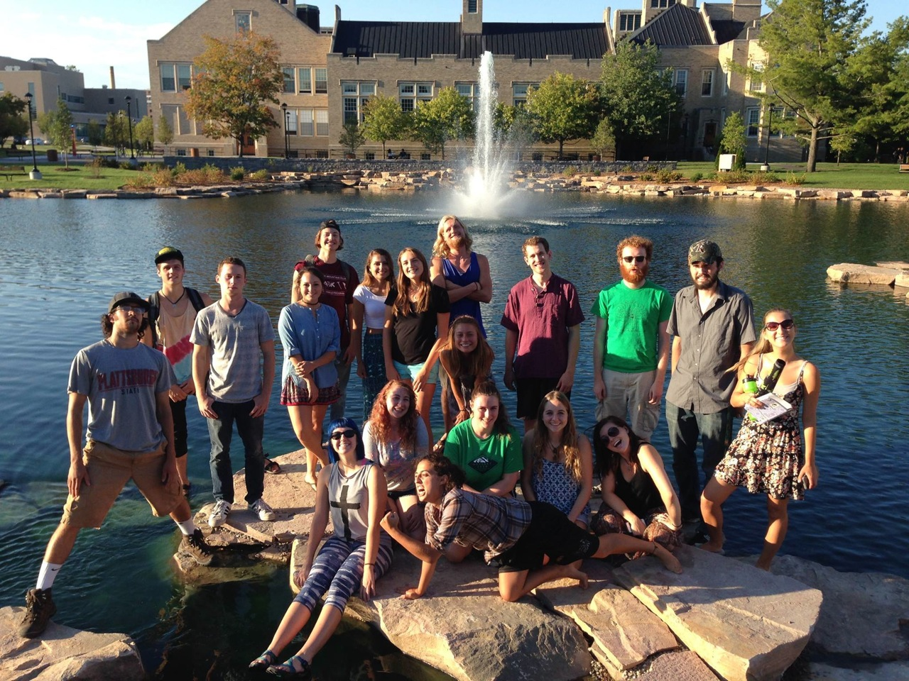 Photo of botany students posing in front of the pond at Hawkins Hall