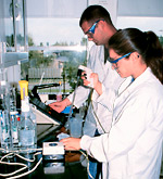 Photo of two students working in the lab