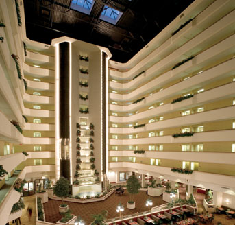 Photo of the glass-roofed atrium of a large, modern hotel