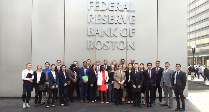 Photo of SUNY Plattsburgh students and faculty advisors in front of the Federal Reserve Bank in Boston