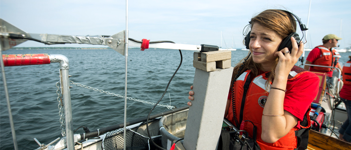 Photo of a student conducting research on Lake Champlain
