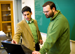 Photo of a student and professor reviewing data